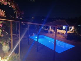 Pool and sunroom at night