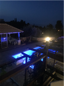 Night view of Pool and Sun Room