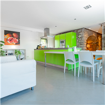 modern kitchen in a stone house for sale in Barcelona, Catalonia, Spain