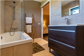 large bathroom shared with high-end materials in a property for sale in the countryside Spain