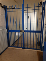 Gate from stairwell to communal entrance