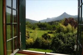 View over the garden and mountains from bedroom 2