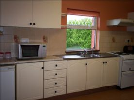 kitchen showing gas cooker,hood,micro/combi,fridge and chest freezer.