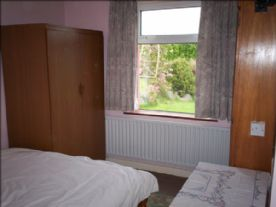 main bedroom 2.88x3.19 ,with garden and rural views.