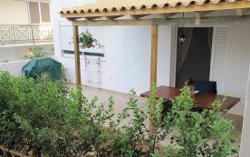 Enclosed rear garden with patio, pergola.