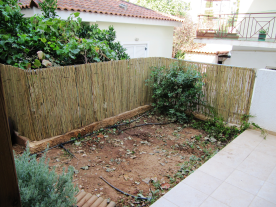 Enclosed rear garden ready to plant vegetables.