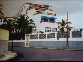 Edif Albert building - pool at the front (behind dyke)