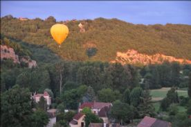 VIEW OF BALLOON OVER VALLEY FROM REAR TERRACE