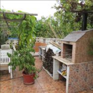 barbecue, sink and shower on main terrace.the wood is for stove in lounge.