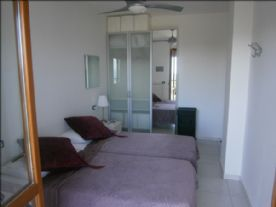 Main bedroom with door to balcony
