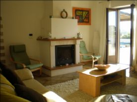 Lounge with large cream sofa and two double sofa beds- its a big lounge