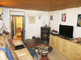Living room, looking through to office and bathroom