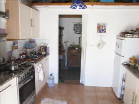 Kitchen and door to library/store room