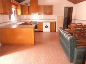 Kitchen/living room with washing machine,fridge/freezer,oven,cooker,fan extractor,tv , tv unit,sofa,wooden table and 4 chairs