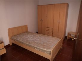 single bed ,triple wardrobe and a bedside drawer