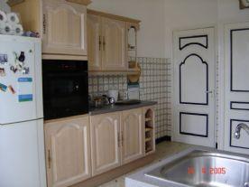 kitchen showing door to hall