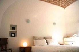 Bedroom 1 with vaulted brick ceiling