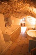 Unique tapering rock bathroom