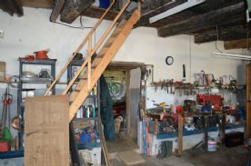 Part of workshop showing access to upper floor and rear garage