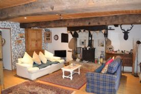 Traditional style lounge with beams