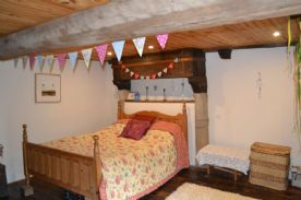 Traditional style bedroom with beams
