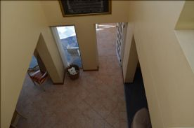 Looking down from gallery/landing to living area.