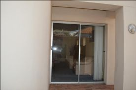 2nd front entrance/sliding doors into lounge.
