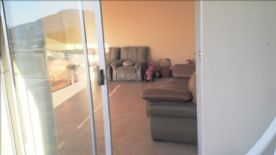 Casual living/family room with sliding doors to terrace.