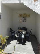 Covered decked dining area in garden