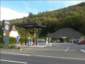 local supermarket with fuel pumps