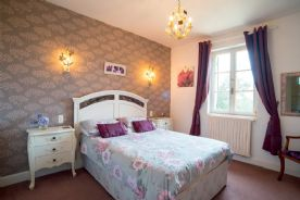 Bedroom, main living level, with bathroom opposite. (11.20 sq m) View to front garden.