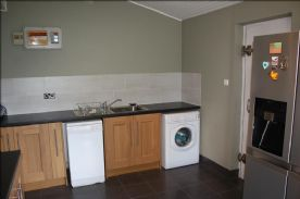 Utility Room with fire door leading to garage
