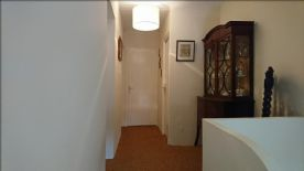 Upstairs hallway leading to separate wc, family bathroom and two bedrooms