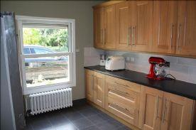 Utility Room Tiverton oak units from UK. Solid oak doors. Radiator, double glazed.