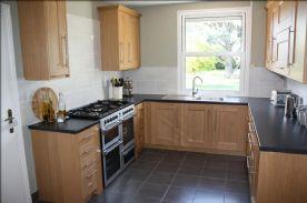 Kitchen  Tiverton Oak units, solid oak doors. 7 burner hob. three ovens and grill. double glazed