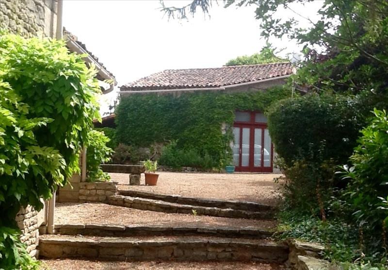 Gite from barn and pool area.